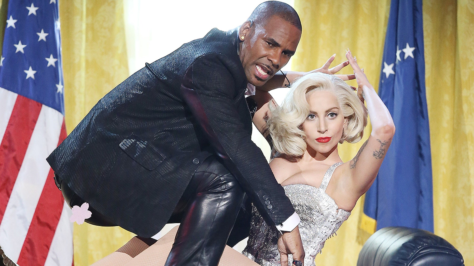 """R. Kelly and Lady Gaga perform """"Do What U Want"""" at the American Music Awards in November 2013."""