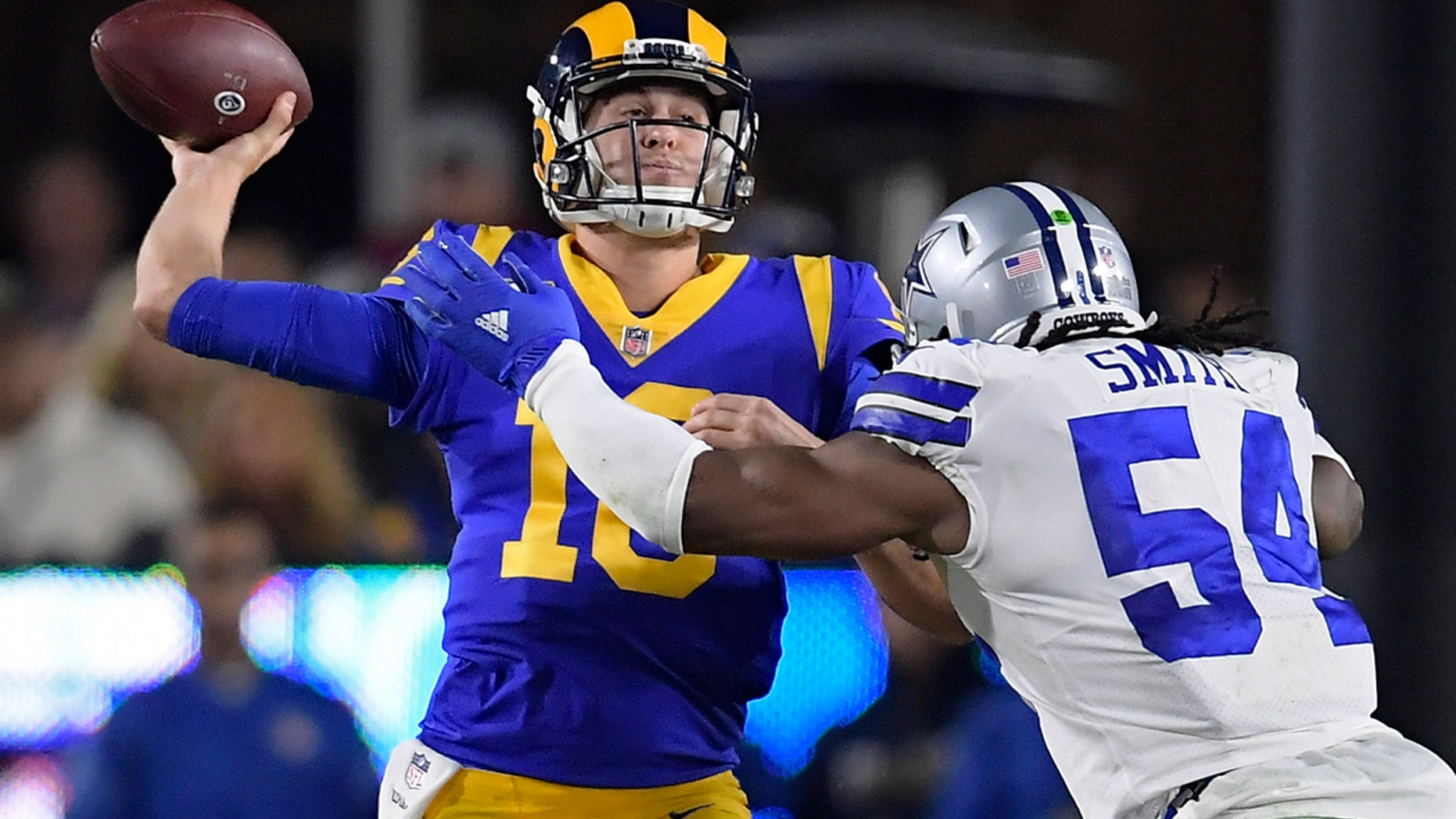 Los Angeles Rams quarterback Jared Goff passes under pressure from Dallas Cowboys middle linebacker Jaylon Smith during the first half in an NFL divisional football playoff game Saturday, Jan. 12, 2019, in Los Angeles. (Associated Press)