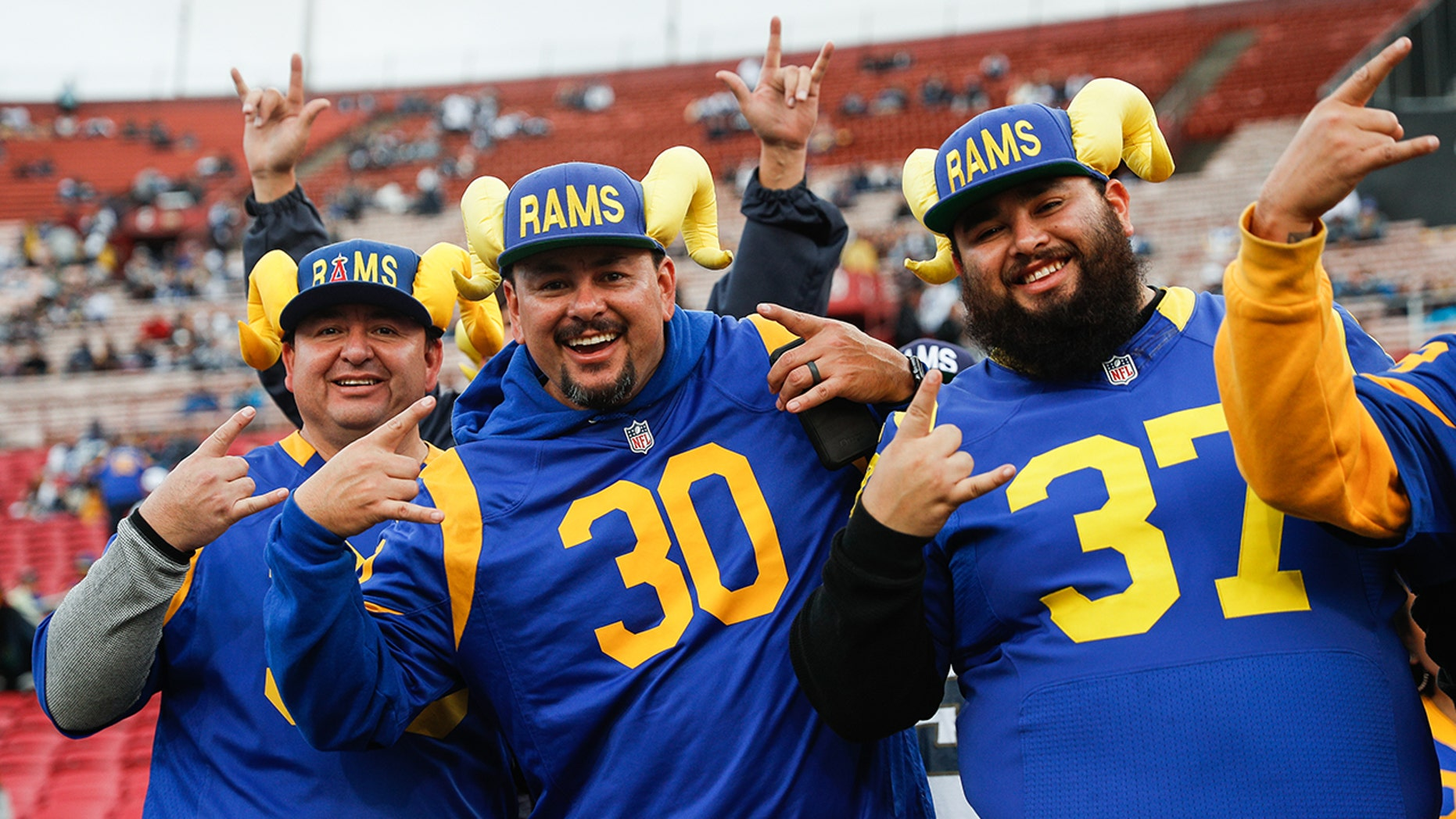 Los Angeles Rams fans pose for a photo ahead of the the NFC Divisional Round playoff game between the Los Angeles Rams and the Dallas Cowboys at Los Angeles Memorial Coliseum on January 12, 2019 in Los Angeles, California.