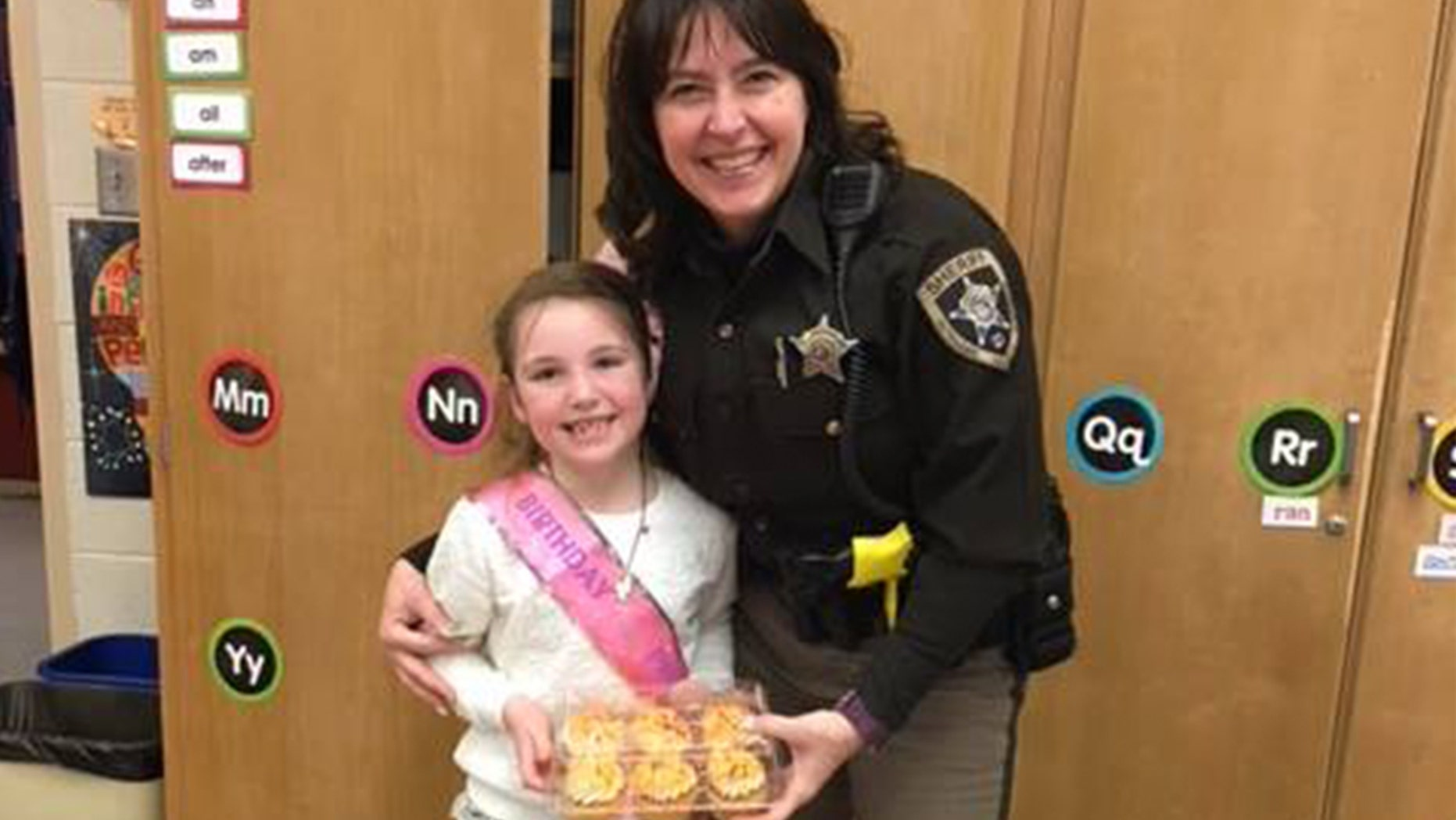 A sheriff's deputy bought cupcakes for a little girl after hers were destroyed in a car wreck.