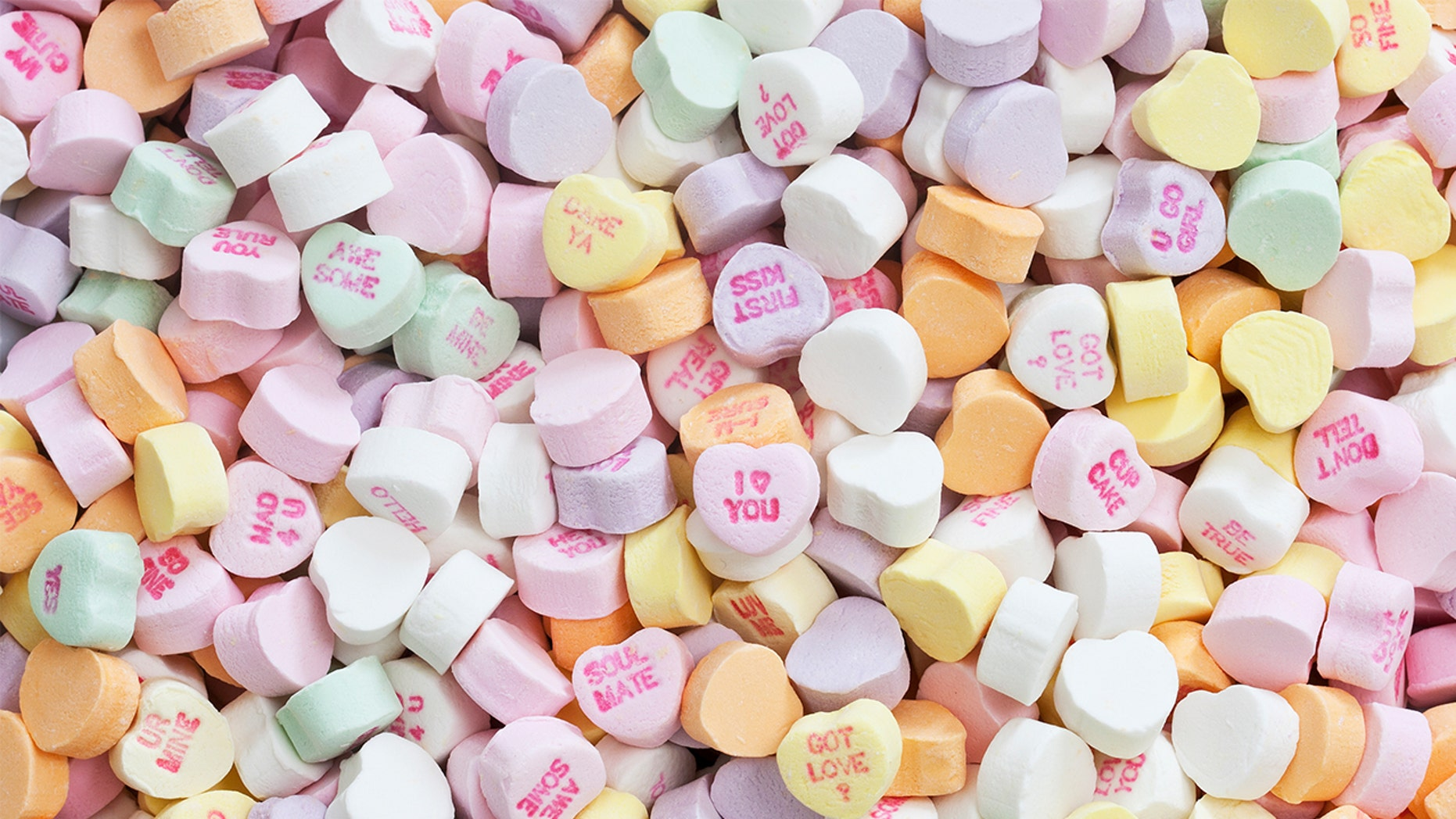 """The pastel heart-shaped candies with phrases like """"Be Mine,"""" Cutie Pie"""" and """"Love You"""" written on them are likely to be in short supply this year."""