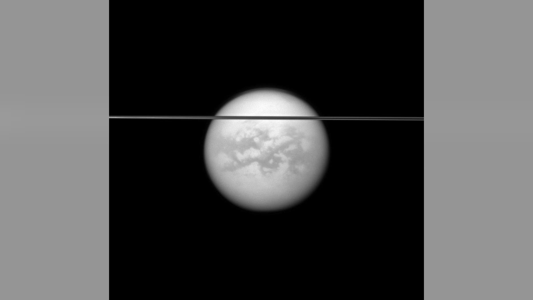 NASA's Cassini spacecraft captured this view of Saturn's largest moon, Titan, with Saturn's rings in the foreground.