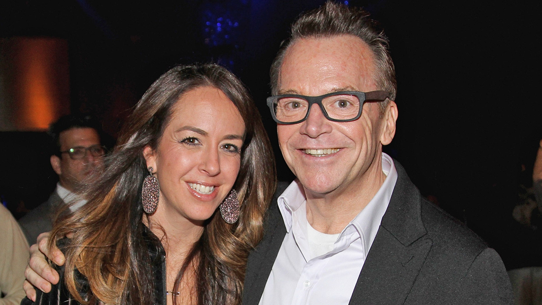 Ashley Groussman and Tom Arnold