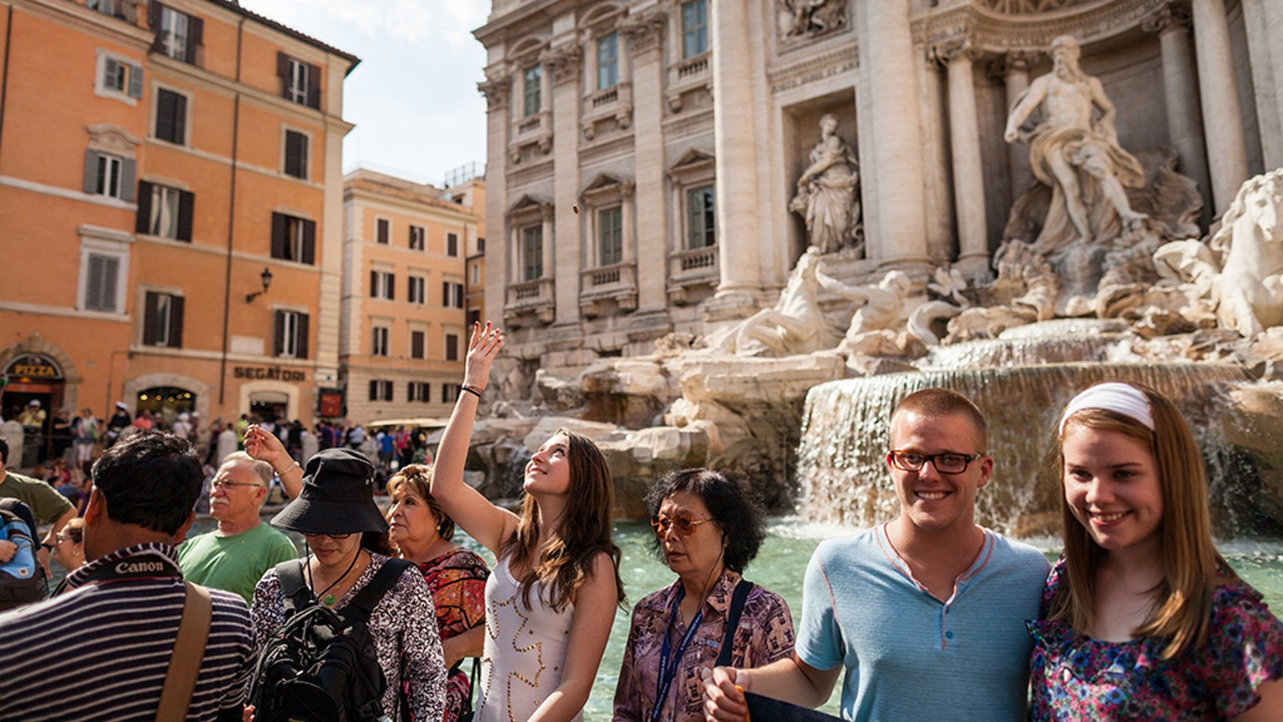 The nearly $1.7 million in coins tossed by tourists in the Trevi fountain in Rome every year. (istock)