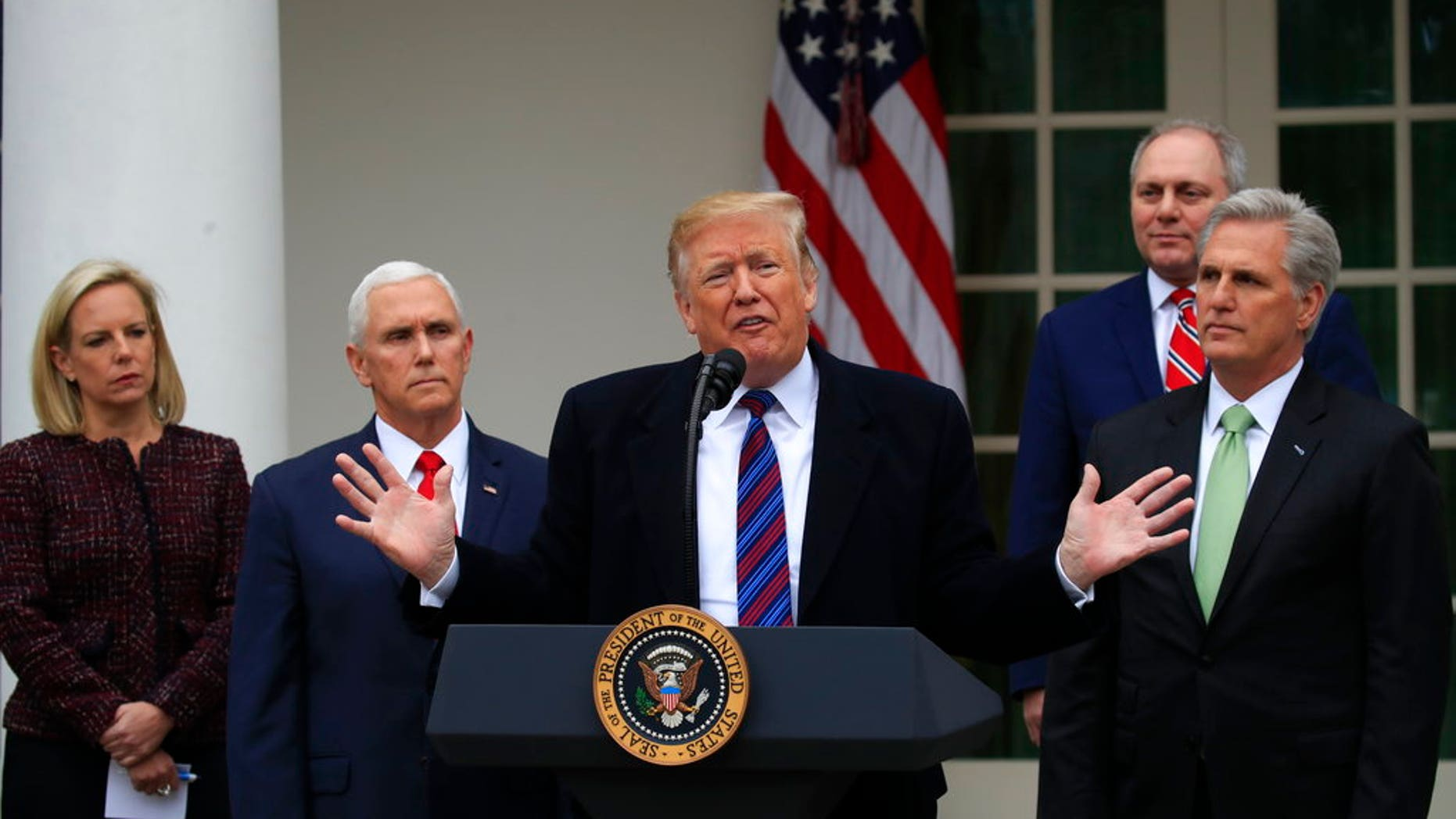 President Donald Trump speaks in the Rose Garden of the White House in Washington, after a meeting with Congressional leaders on border security, as the government shutdown continues Friday, Jan. 4, 2019, as Homeland Security Secretary Kirstjen Nielsen, Vice President Mike Pence, House Minority Whip Steve Scalise of La., and House Minority Leader Kevin McCarthy of Calif., listen. (AP Photo/Manuel Balce Ceneta)