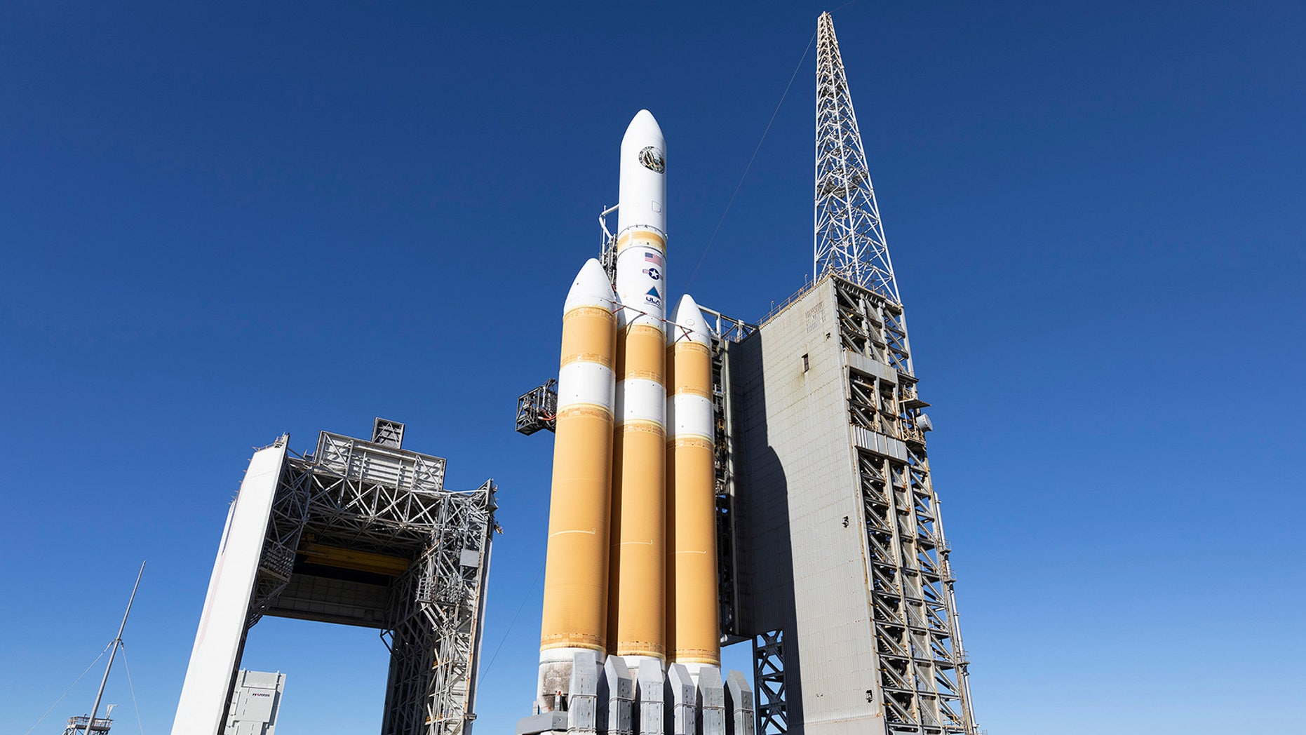 The mobile service tower rolls back from the United Launch Alliance (ULA) Delta IV Heavy rocket carrying NRO's NROL-71 mission in preparation for launch from Space Launch Complex 6 at Vandenberg Air Force Base in California. Liftoff is targeted for Jan. 19, 2018.