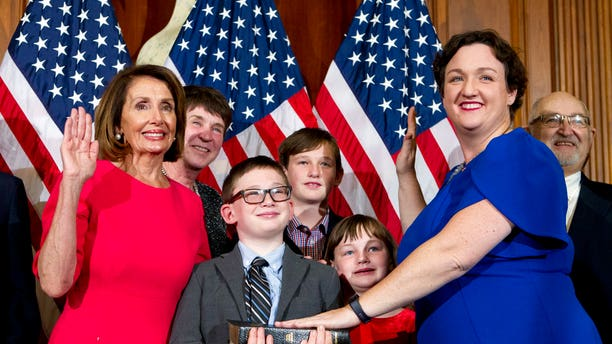House Speaker Nancy Pelosi of Calif., administers the House oath of office to Rep. Katie Porter, D-Calif., during ceremonial swearing-in on Capitol Hill in Washington, Thursday, Jan. 3, 2019, during the opening session of the 116th Congress. (AP Photo/Jose Luis Magana)
