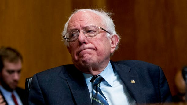 "FILE - In this Jan. 16, 2019, photo, Sen. Bernie Sanders, I-Vt., reacts during a hearing on Capitol Hill in Washington. ""Medicare-for-all"" makes a good first impression, but support plunges when people are asked if they'd pay higher taxes or put up with treatment delays to get it. AP"