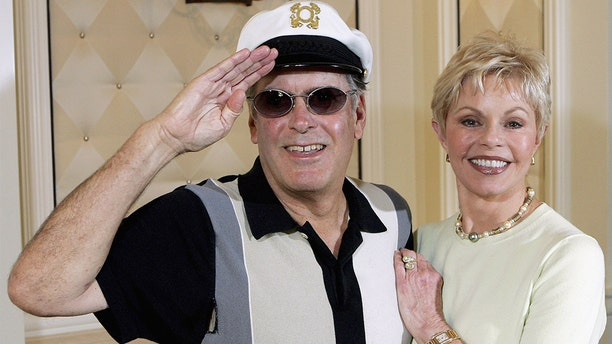 """""""Captain"""" Daryl Dragon has died. He was 76. The late musician is pictured here with Toni Tennille in 2005."""