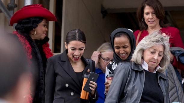From left, Rep. Frederica Wilson, D-Fla., Rep. Alexandria Ocasio-Cortez, D-N.Y., Rep. Ilhan Omar, D-Minn., Rep. Cheri Bustos, D-Ill., and Rep. Dina Titus, D-Nev., walk down the House steps.