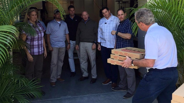 Former President George W. Bush posted a picture to his instagram account on Friday, delivering pizzas to Secret Service personnel.
