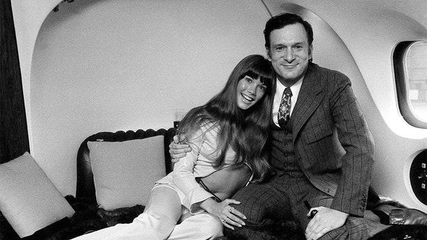 Playboy chief Hugh Hefner with model Barbi Benton, aboard his private Douglas DC9-30 plane, nicknamed The Big Bunny.