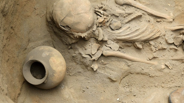 File photo - This picture is a view of human remains and pottery items dating more than 1,500 years, found at an excavation site in the northern coastal town of Huanchaco, in Peru on March 21, 2018.