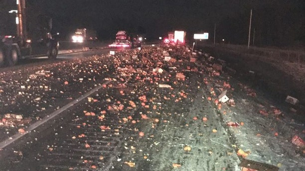 Oranges spilled out across Interstate 70 in Indiana after a crash.