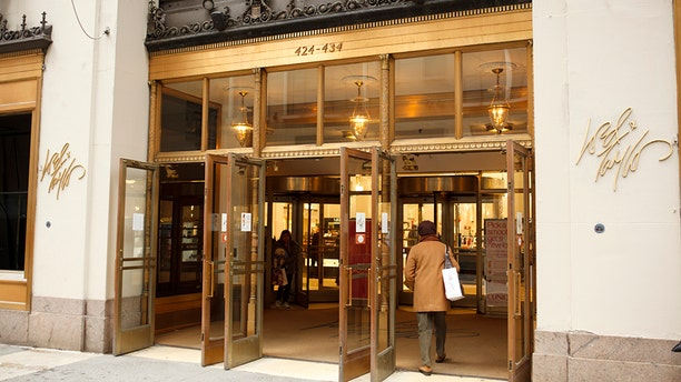 New York, New York, USA - March 14, 2011: The entrance to the well known Lord and Taylor flagship department store on fifth avenue in Manhattan. A woman is seen entering through the exterior doors. The Lord and Taylor stores date back to the 1800's.