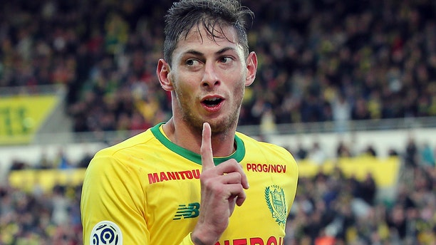 Argentine soccer player, Emiliano Sala, of the FC Nantes club, western France, reacts after scoring during a soccer match against Guingam, in Nantes, France. The French civil aviation authority says Emiliano Sala was aboard a small passenger plane that went missing off the coast of the island of Guernsey. (AP Photo/David Vincent)