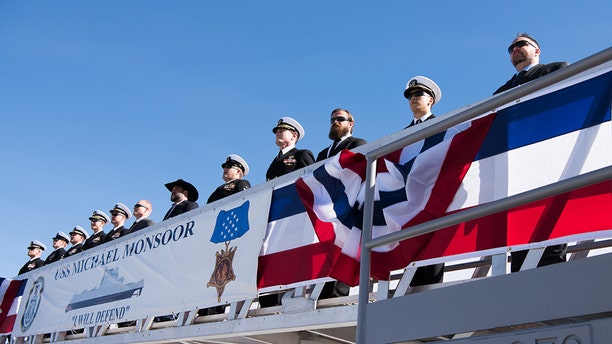 SAN DIEGO (Jan. 26, 2019) Former members of SEAL Team 3 join the ship's crew to bring the Navy's newest Zumwalt-class guided-missile destroyer, USS Michael Monsoor (DDG 1001), to life during its commissioning ceremony. Michael Monsoor is the second Zumwalt destroyer ship to enter the fleet. It is the first Navy combat ship named for fallen Master-at-Arms 2nd Class (SEAL) Michael Monsoor, who was posthumously awarded the Medal of Honor for his heroic actions while serving in Ramadi, Iraq, in 2006. (U.S. Navy photo by Mass Communication Specialist 3rd Class Devin M. Monroe/Released)