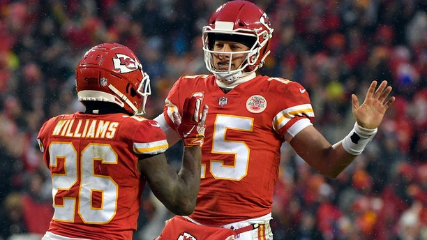 Kansas City Chiefs quarterback Patrick Mahomes (15) celebrates a touchdown with running back Damien Williams (26) during the first half of an NFL divisional football playoff game against the Indianapolis Colts in Kansas City, Mo., Saturday, Jan. 12, 2019. (Associated Press)