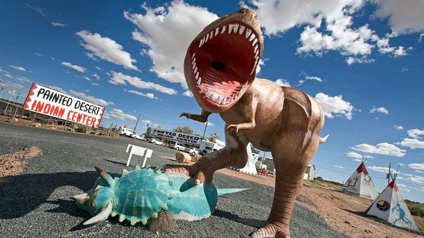 A dinosaur model greets visitors near Arizona's Painted Desert.