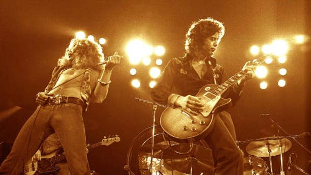 Jimmy Page and Robert Plant performing live onstage.