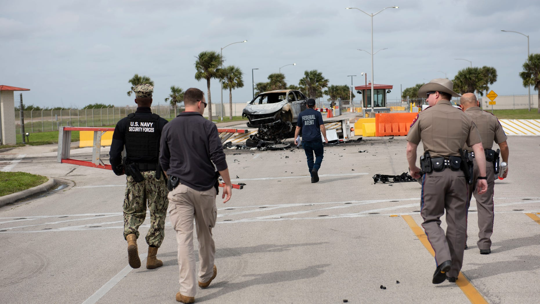 A man who crashed his car through the gate of a Texas naval base early Thursday and tried to attack security personnel was shot and killed.