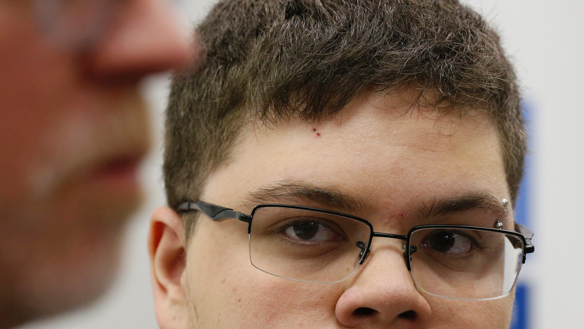 FILE - In this March 6, 2017, file photo, Gloucester County High School senior Gavin Grimm, a transgender student, listens to a speaker during a news conference in Richmond, Va. Grimm is continuing to sue the Gloucester County School Board in Virginia over a policy that banned him from using the boys' bathrooms. He's now trying to amend the suit to include the matter of his unchanged transcripts. (AP Photo/Steve Helber, File)