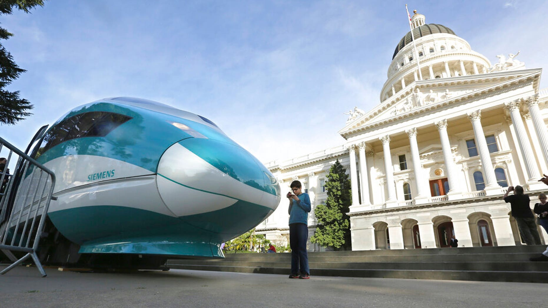 FILE - In this Feb. 26, 2015, file photo, a full-scale mock-up of a high-speed train is displayed at the Capitol in Sacramento, Calif. (Associated Press)
