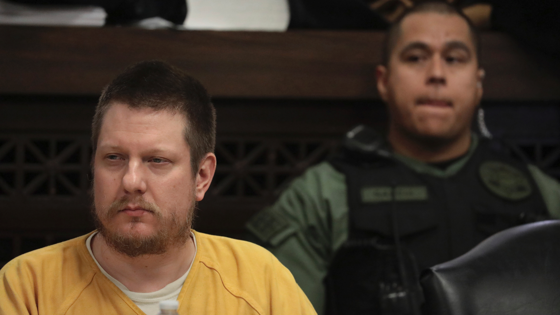 FILE - In this Jan. 18, 2019 file photo, former Chicago police Officer Jason Van Dyke attends his sentencing hearing at the Leighton Criminal Court Building in Chicago, for the 2014 shooting of Laquan McDonald. Illinois' attorney general is holding a news conference with the prosecutor who won a conviction against the white Chicago police officer who killed black teenager Laquan McDonald. Neither Attorney General Kwame Raoul nor Kane County State's Attorney Joseph McMahon have said what Monday's news conference is about. It comes after Raoul's office signaled that it may ask the Illinois Supreme Court to intervene over what prosecutors see as a too lenient sentence for Jason Van Dyke. (Antonio Perez/Chicago Tribune via AP, Pool, File)