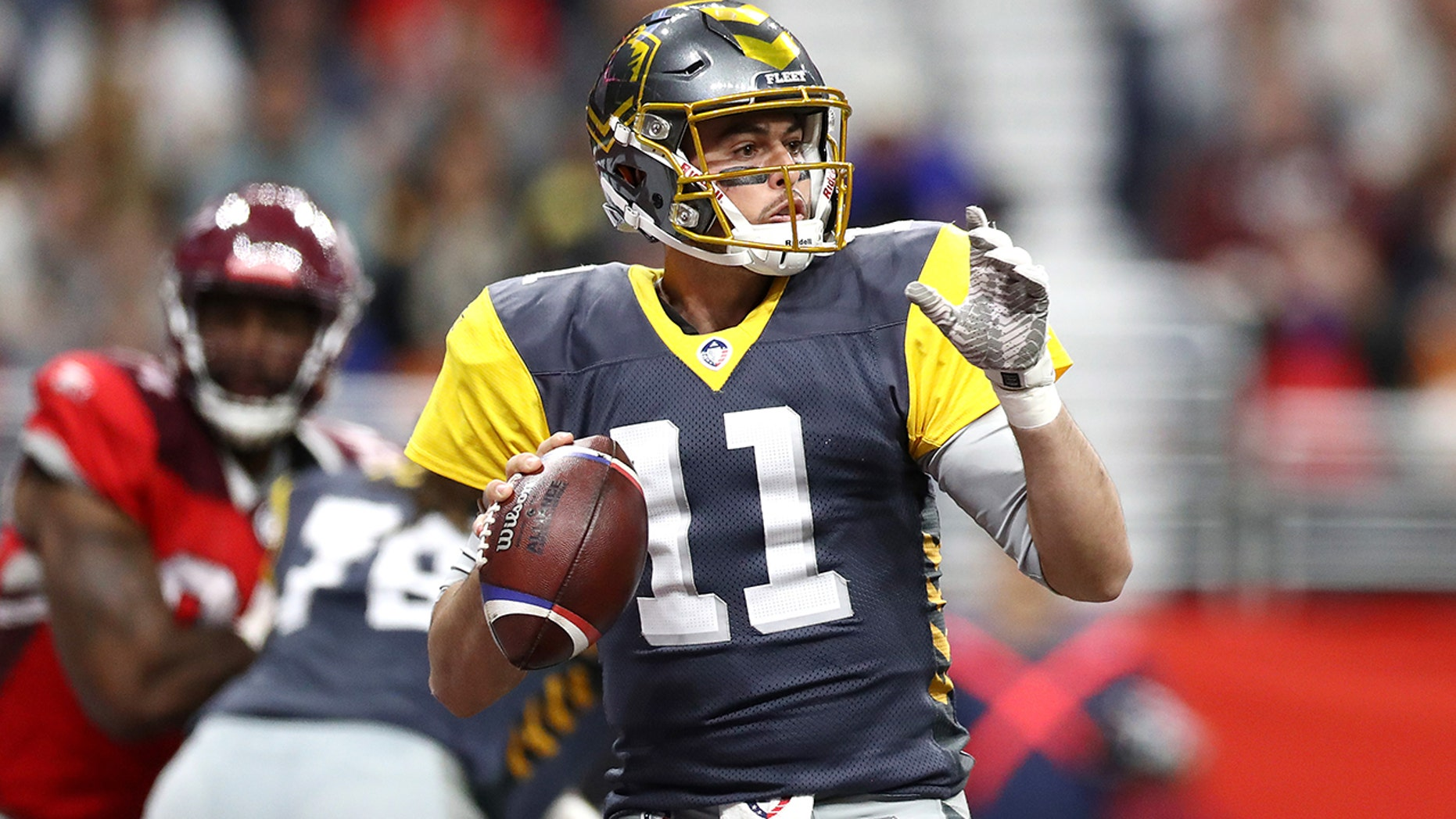 MikeBercovici #11 of the San Diego Fleet looks to pass the ball during the first half against the the San Antonio Commanders in an Alliance of American Football game at the Alamodome