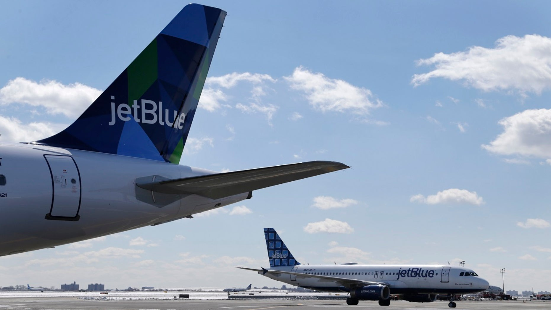 Jet Blue airplanes on the tarmac at John F. Kennedy International Airport in New York. (Associated Press)