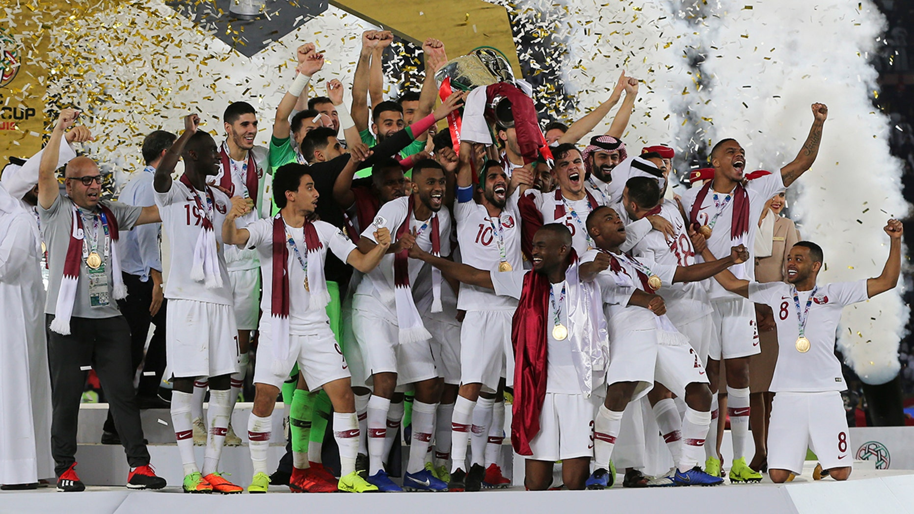 Qatars players lift the trophy after winning the AFC Asian Cup final match between Japan and Qatar in Zayed Sport City in Abu Dhabi, United Arab Emirates, Friday, Feb. 1, 2019.