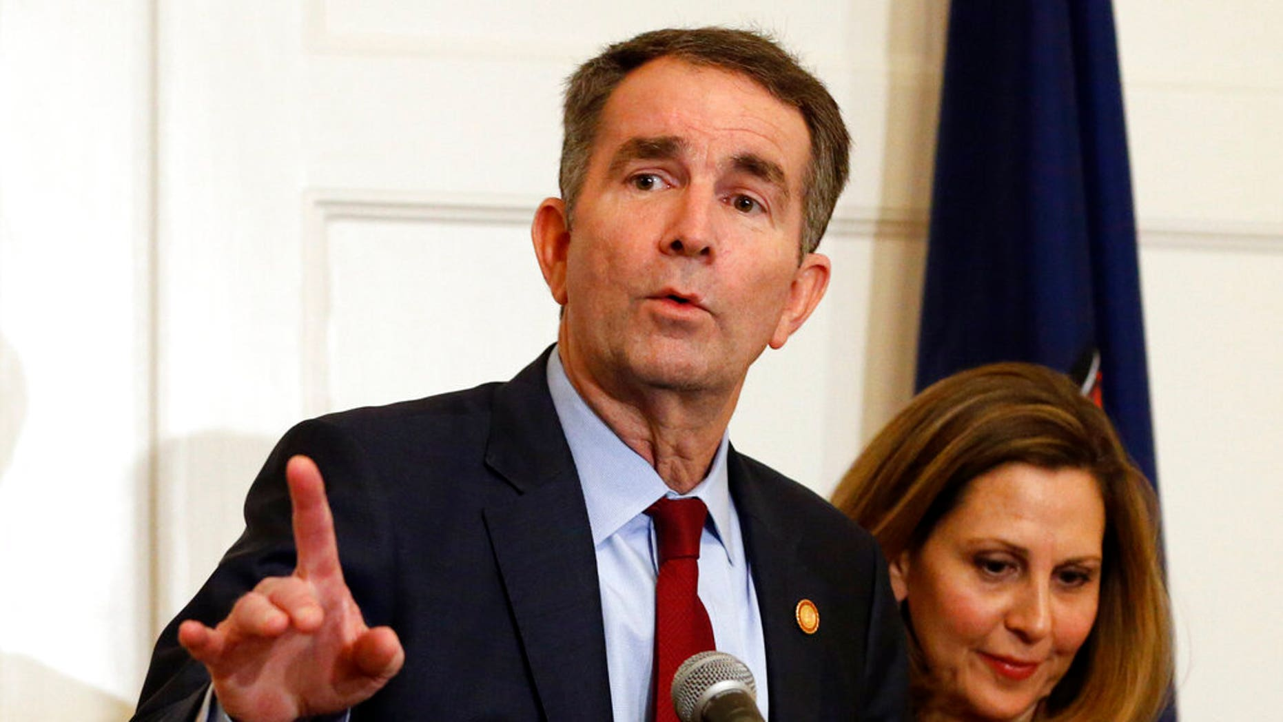 Pam Northarm, right, appears alongside her husband, Virginia Gov. Ralph Northam, during a news conference earlier this month. (AP Photo/Steve Helber)