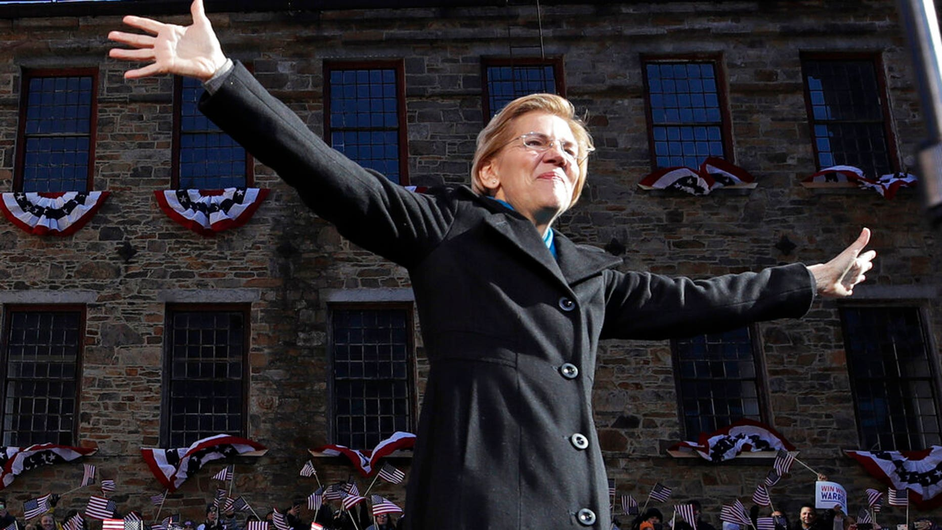 Sen. Elizabeth Warren, D-Mass., acknowledges cheers as she takes the stage during an event to formally launch her presidential campaign.