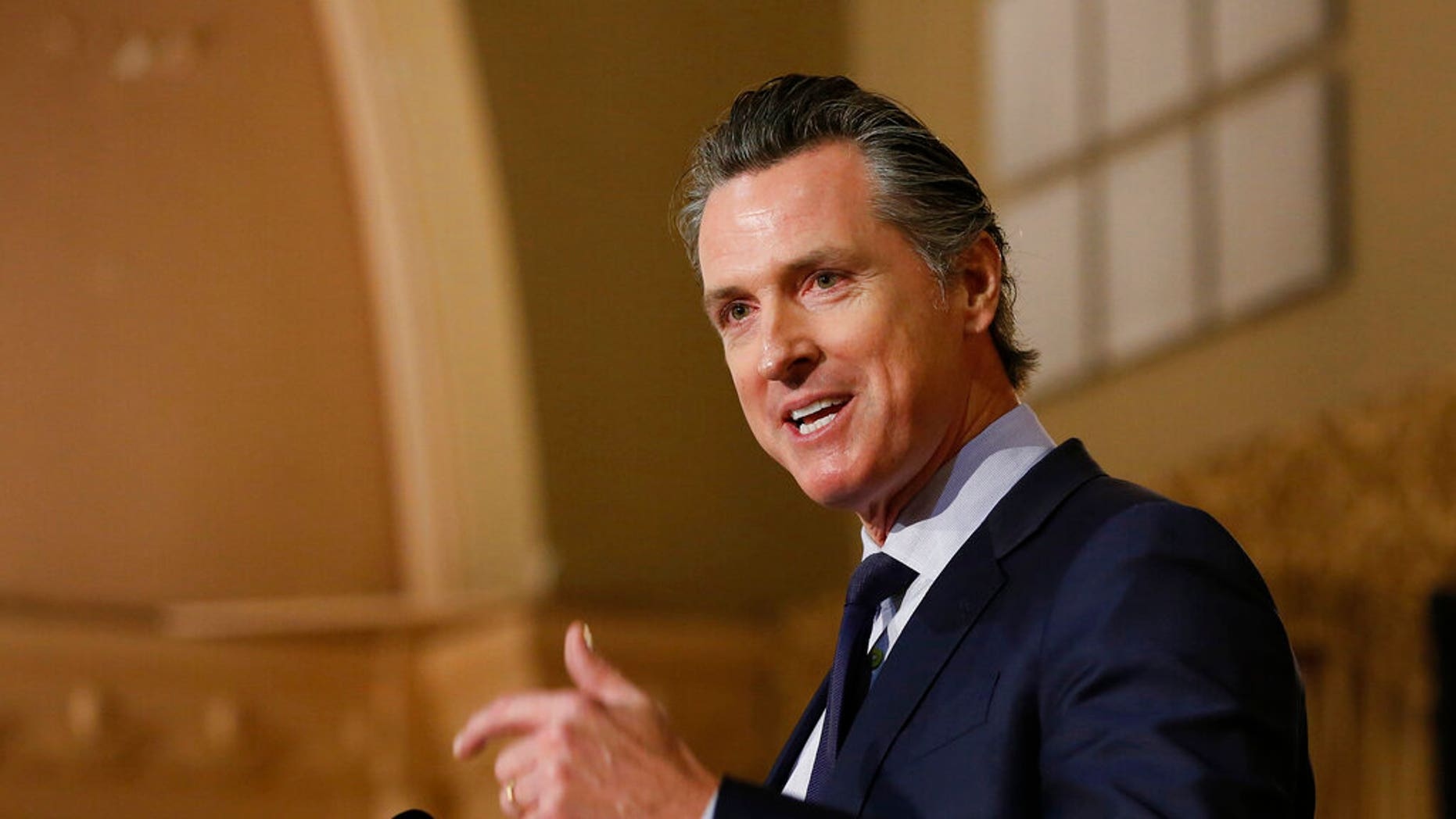 FILE: Gov. Gavin Newsom speaks at the California Legislative Black Caucus Martin Luther King Jr., Breakfast, in Sacramento, Calif.