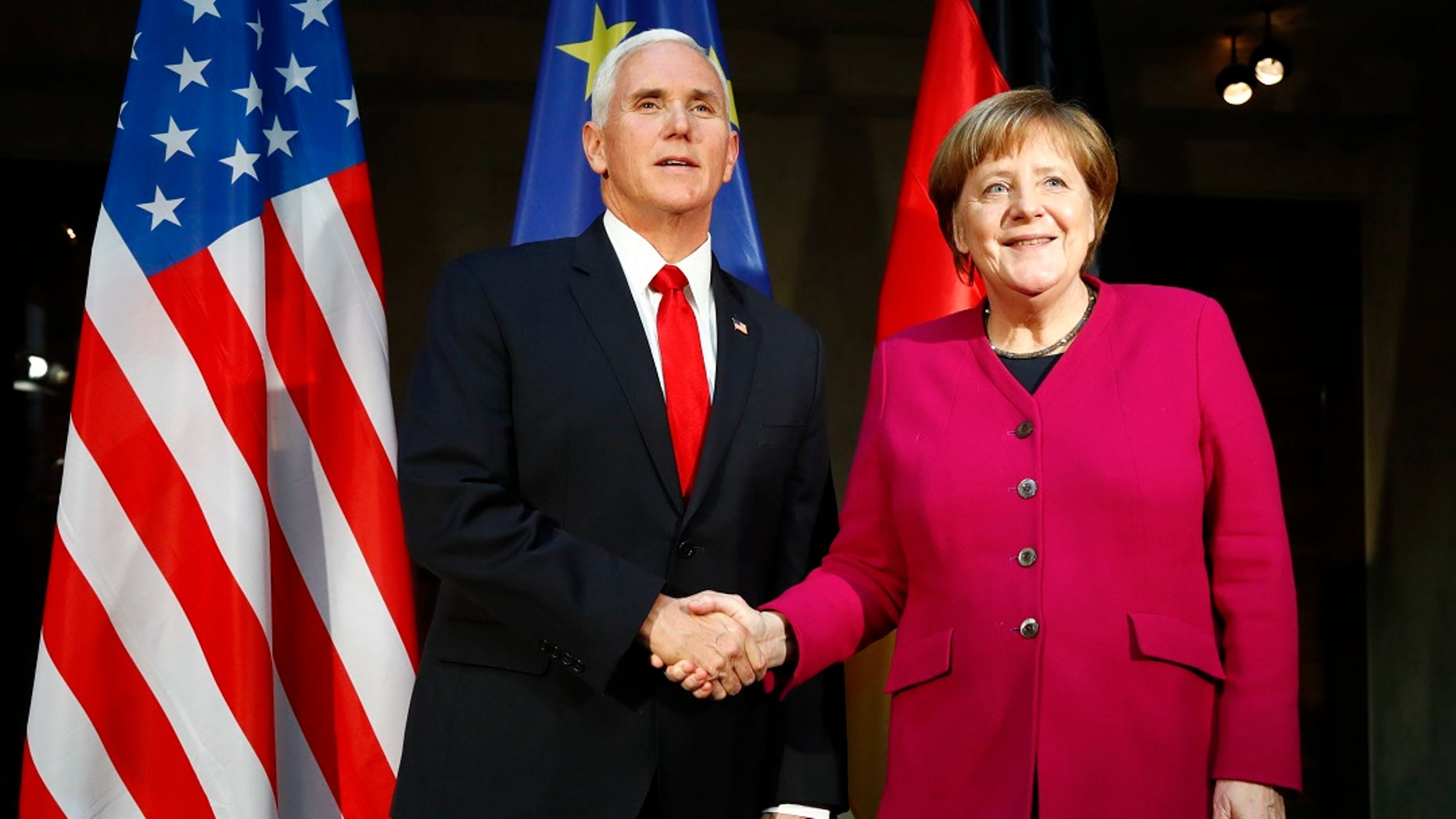 Vice President Mike Pence and German Chancellor Angela Merkel meet at the Munich Security Conference in Munich, Germany, Feb. 16, 2019. (Associated Press)