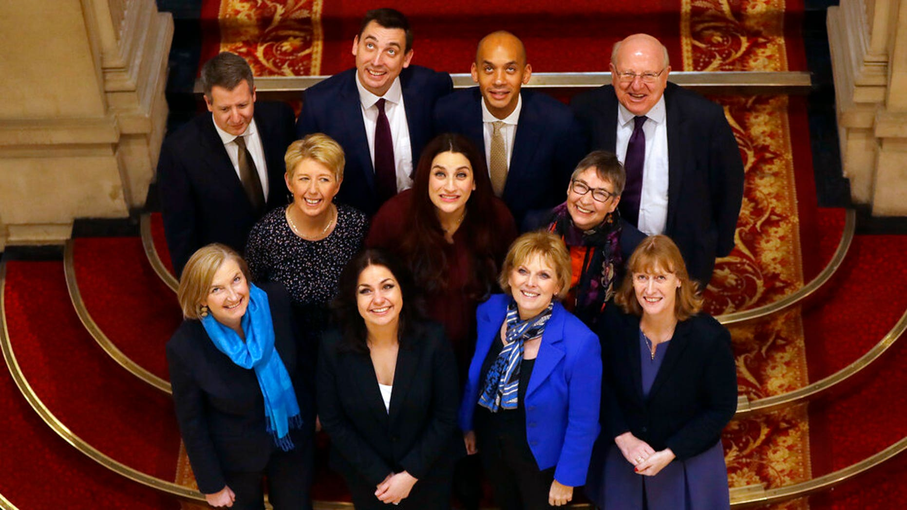 Eleven British politicians who have joined new political party 'The Independent Group' pose for a photograph after a press conference in Westminster in London, Wednesday, Feb. 20, 2019.