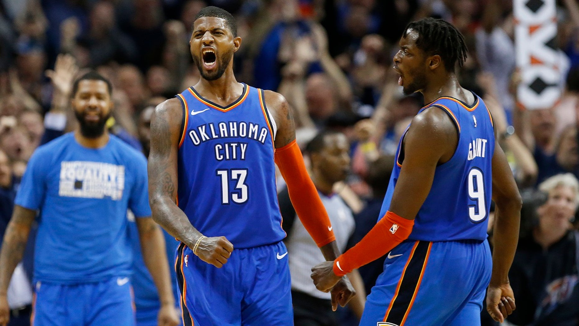 Oklahoma City Thunder forwards Paul George (13) and Jerami Grant (9) celebrate after George hit a shot with less than a second left in the second overtime of an NBA basketball game against the Utah Jazz in Oklahoma City, Friday, Feb. 22, 2019. The Thunder won 148-147.