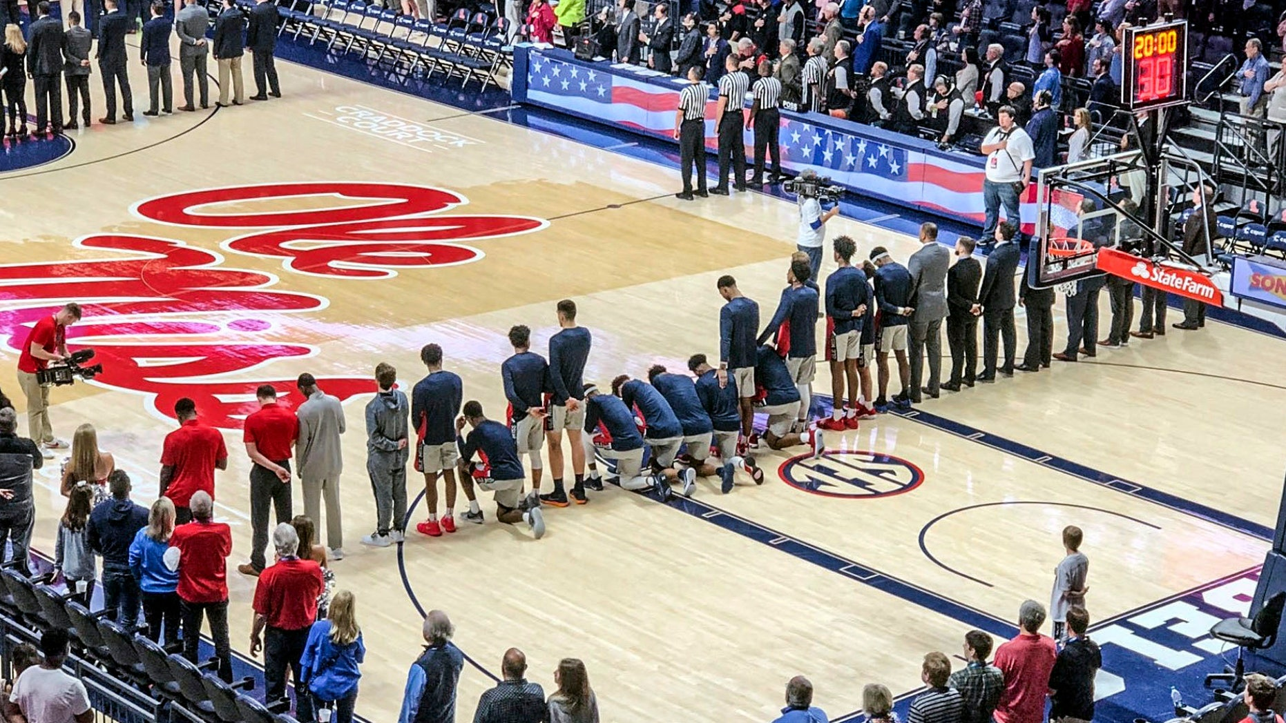 Six Mississippi basketball players take a knee during the national anthem before an NCAA college basketball game against Georgia in Oxford on Saturday.