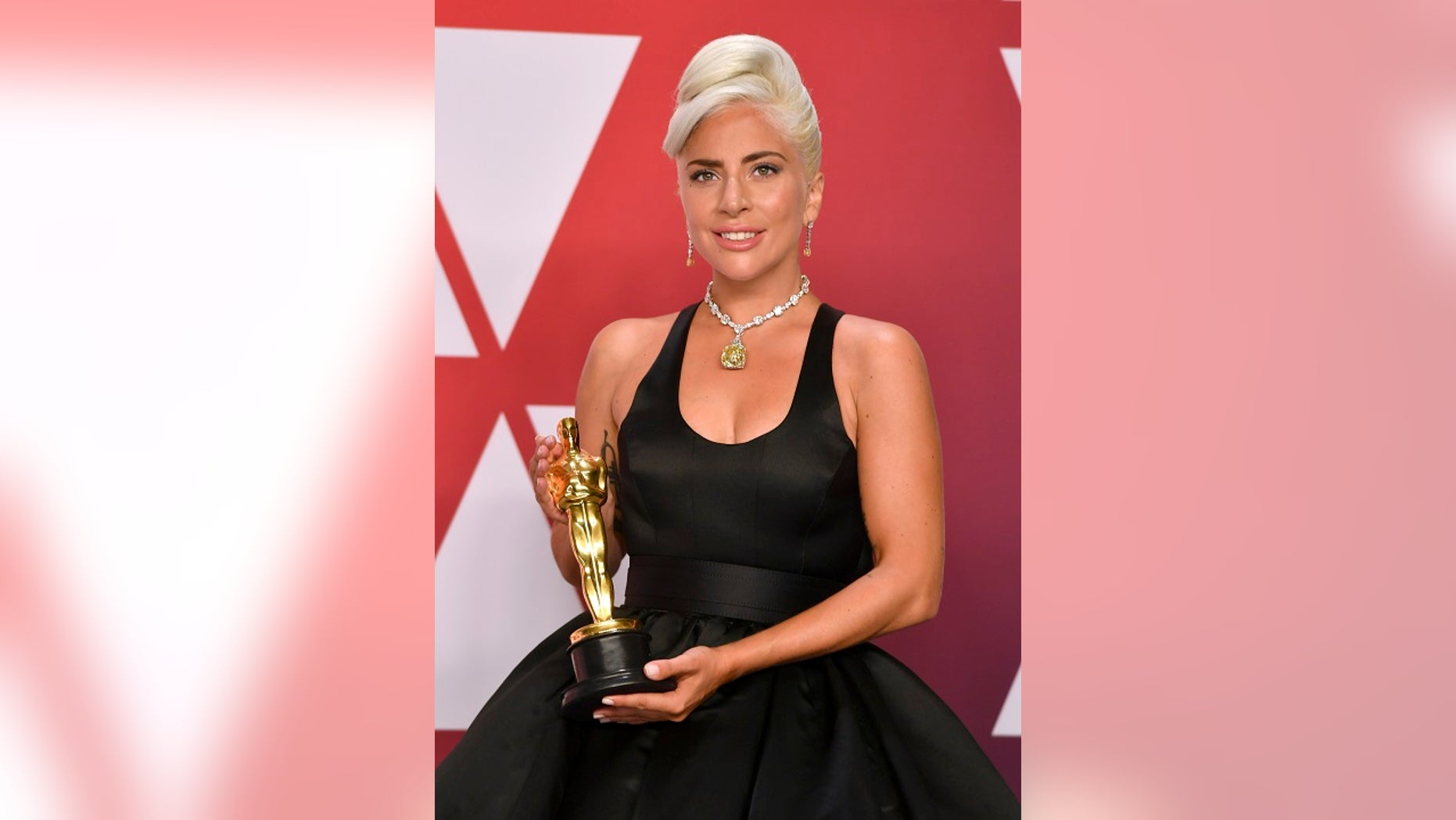 """Lady Gaga, winner of the award for best original song for """"Shallow"""" from """"A Star Is Born"""", poses in the press room at the Oscars on Sunday, Feb. 24, 2019, at the Dolby Theatre in Los Angeles. (Photo by Jordan Strauss/Invision/AP)"""