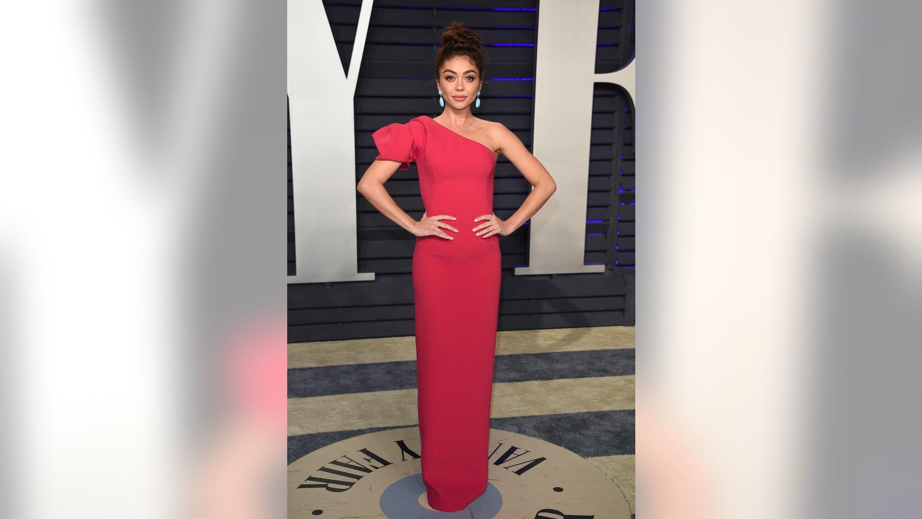 Sarah Hyland arrives at the Vanity Fair Oscars.