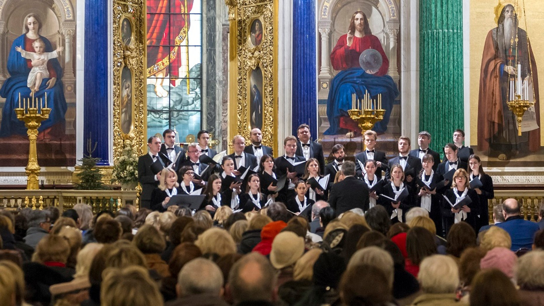FILE 2018: Concert Choir performs at the St. Isaac's Cathedral in St. Petersburg, Russia. A choir in the Russian city of St. Petersburg has drawn criticism for performing a satirical song about firing a missile on the United States from a Soviet nuclear submarine. (Roman Pimenov, Interpress photo agency via AP)