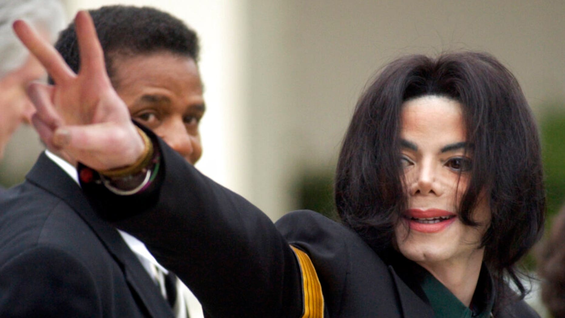 Michael Jackson waves to his supporters as he arrives for his child molestation trial at the Santa Barbara County Superior Court in Santa Maria, Calif., March 2, 2005. (Associated Press)