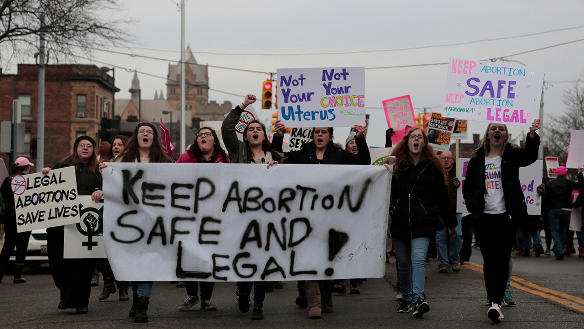 Supporters of Planned Parenthood rally outside a Planned Parenthood clinic in Detroit, Michigan, U.S. February 11, 2017. REUTERS/Rebecca Cook - RC15C2B406B0