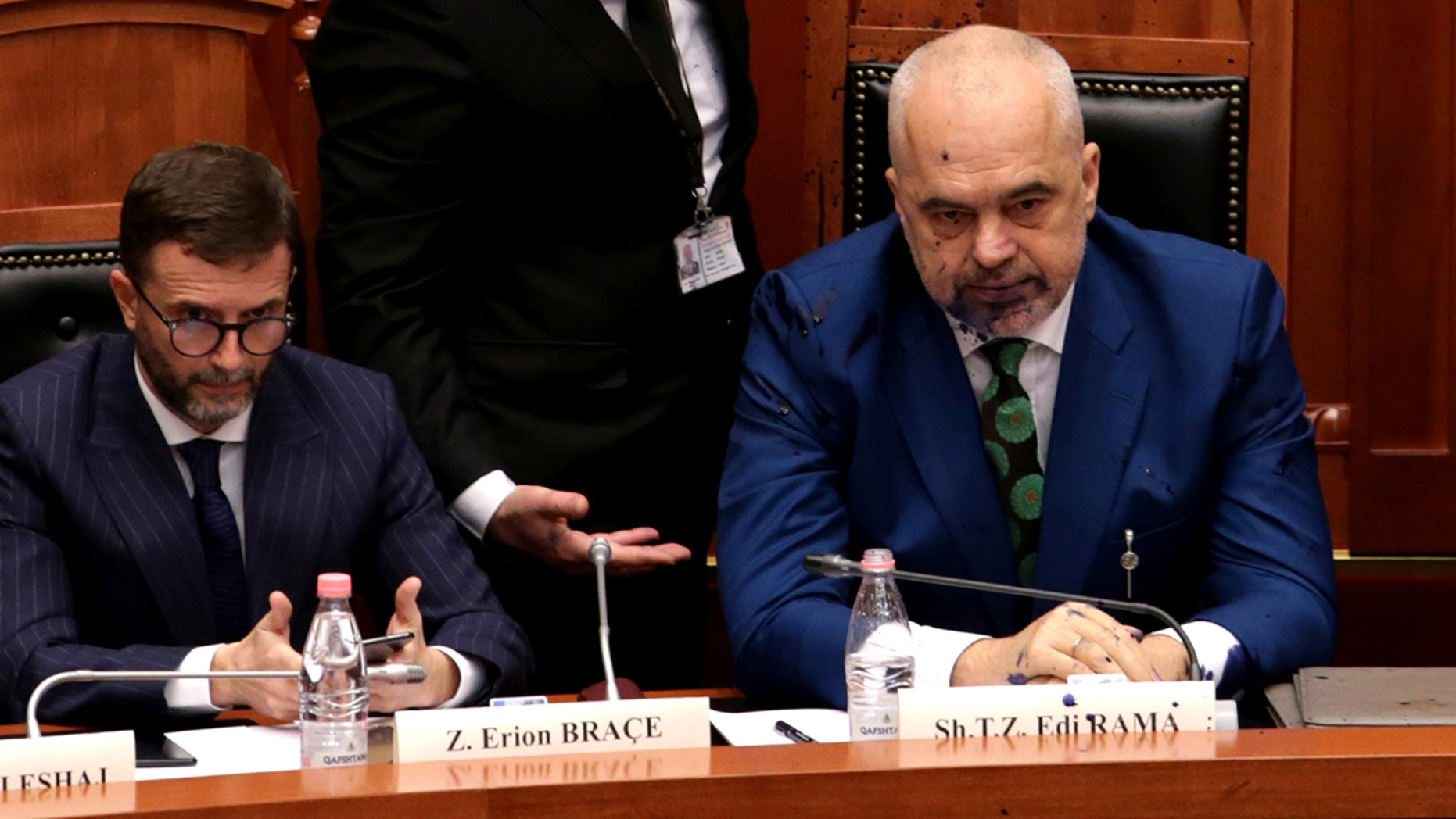 Albania's Prime Minister Edi Rama (right) looks on after liquid substance was thrown at him by members of the opposition during parliamentary session in Tirana, Albania, February 14, 2019.