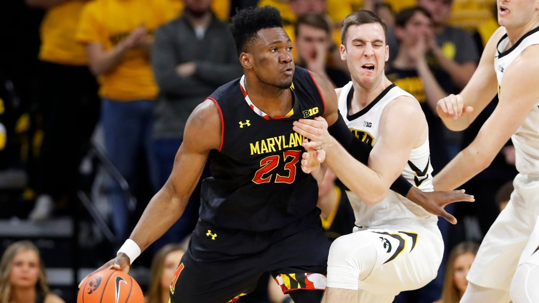 Maryland forward Bruno Fernando (23) drives past Iowa guard Connor McCaffery during the second half of an NCAA college basketball game Tuesday, Feb. 19, 2019, in Iowa City, Iowa.