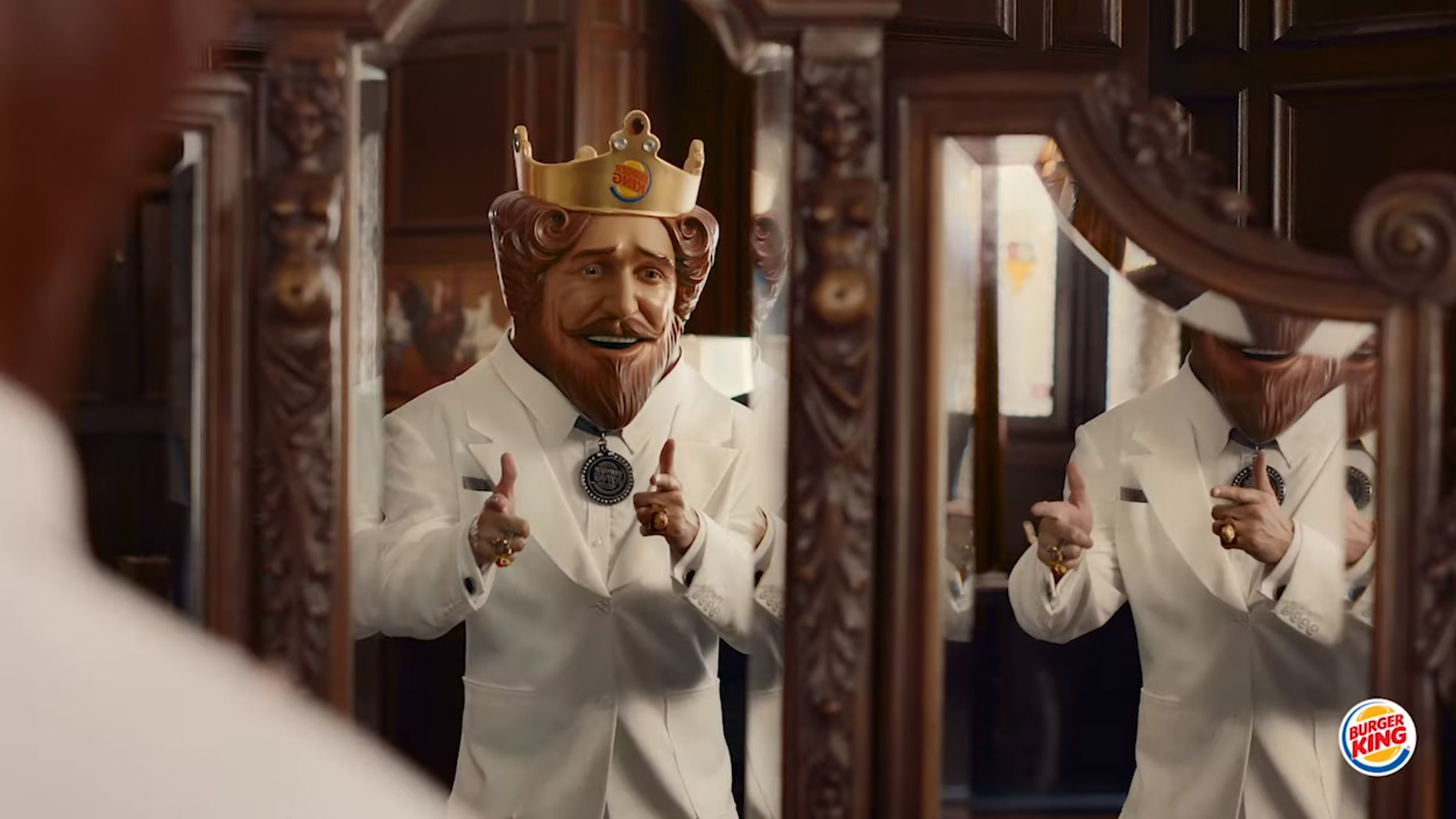 """""""When it comes to flame grillin,' a king always outranks a colonel,"""" a new ad campaign tells viewers."""