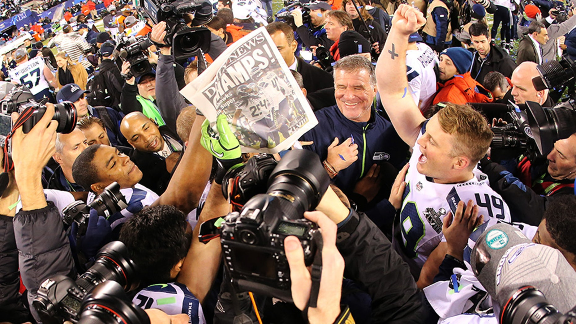 EAST RUTHERFORD, NJ - FEBRUARY 02: Long snapper Clint Gresham #49 of the Seattle Seahawks celebrates with teammates on the field after winning Super Bowl XLVIII at MetLife Stadium on February 2, 2014 in East Rutherford, New Jersey. The Seahawks beat the Broncos 43-8.