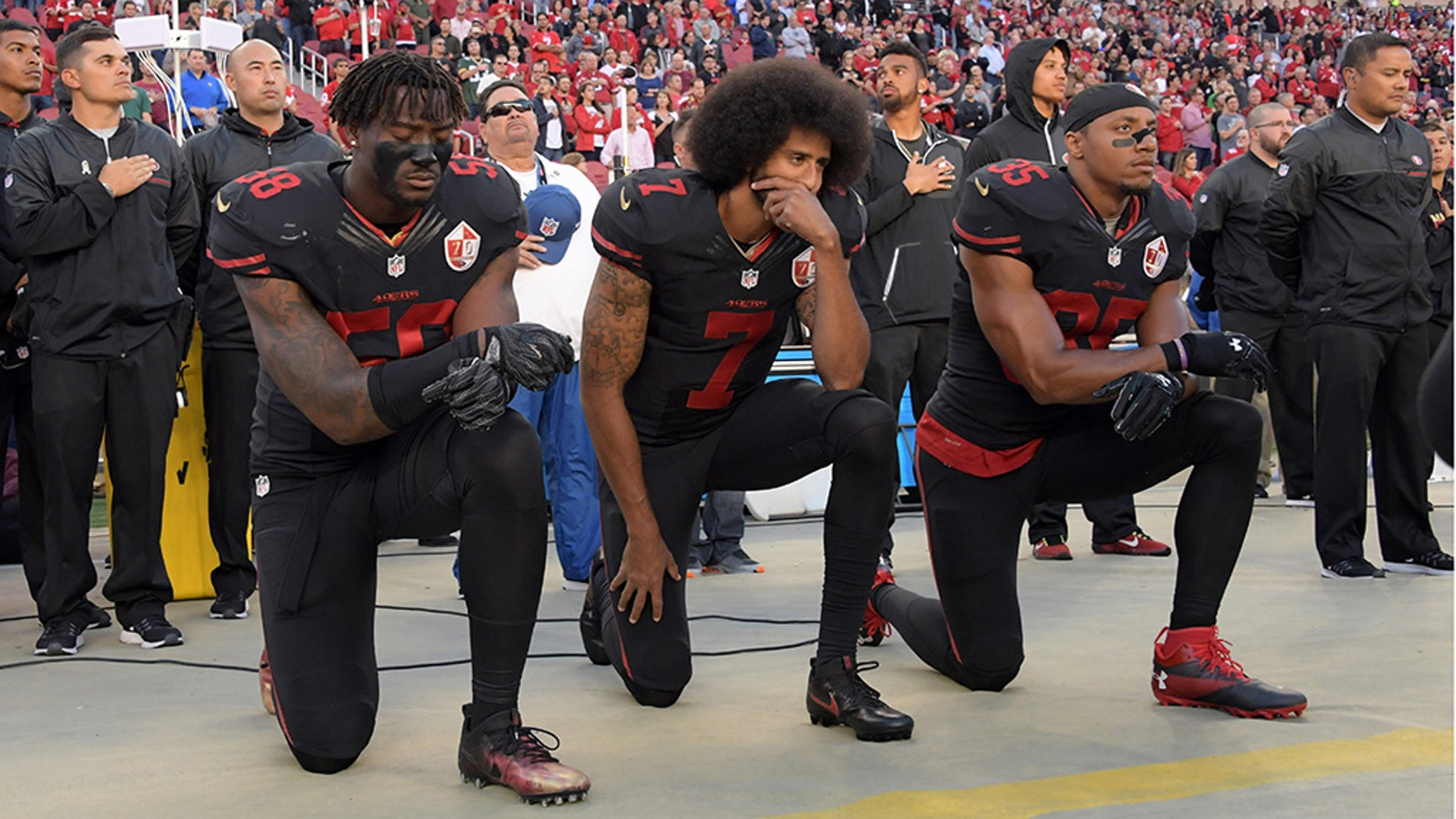 San Francisco 49ers linebacker Eli Harold (58), quarterback Colin Kaepernick (7) and free safety Eric Reid (35) kneel in protest during the playing of the national anthem before a NFL game in 2016. (USA TODAY Sports)