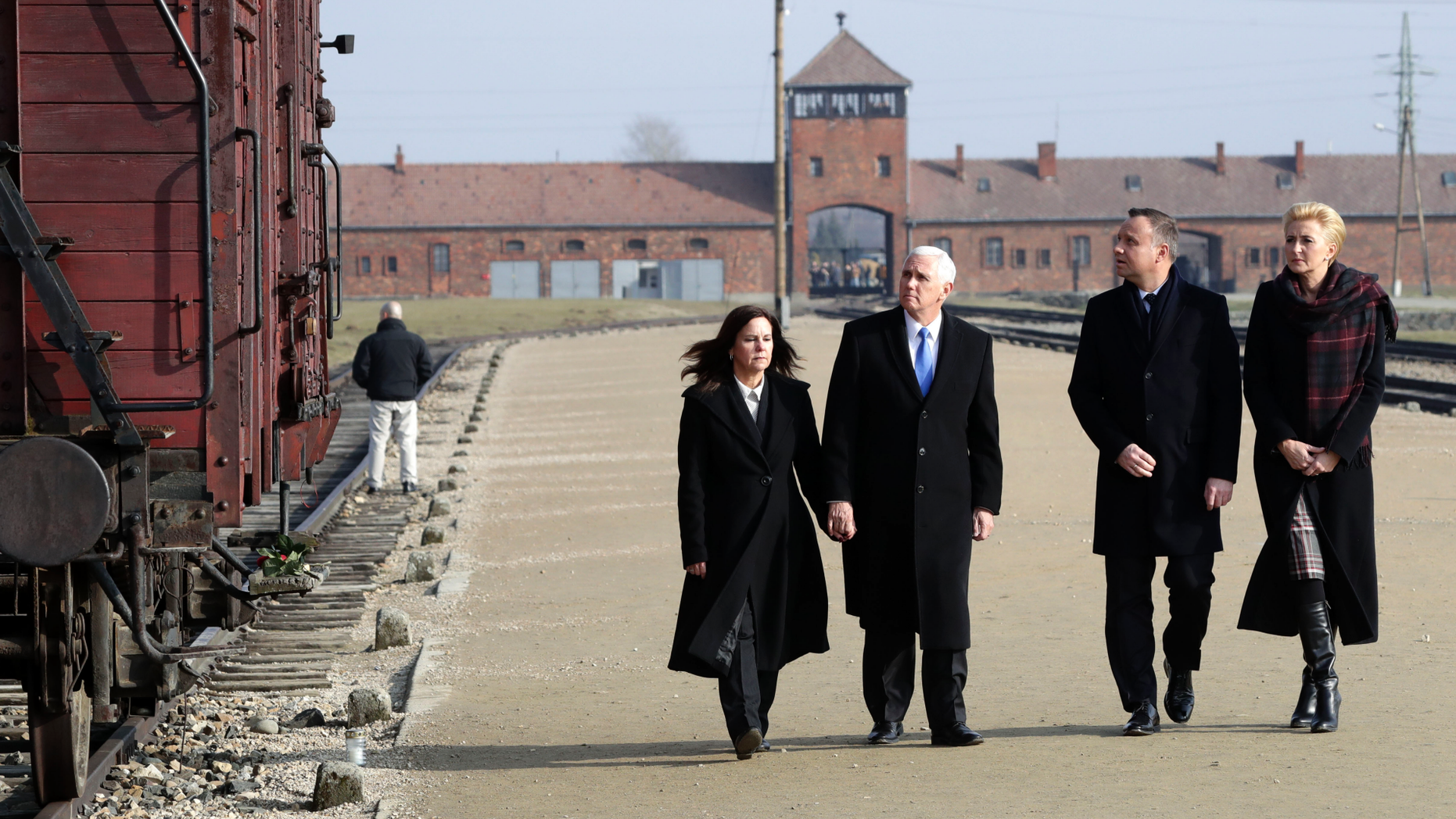 United States Vice President Mike Pence and his wife Karen Pence, left, walk with Poland's President Andrzej Duda and his wife Agata Kornhauser-Duda, right, during their visit at the Nazi concentration camp Auschwitz-Birkenau in Oswiecim, Poland, Friday, Feb. 15, 2019. (AP Photo/Michael Sohn)