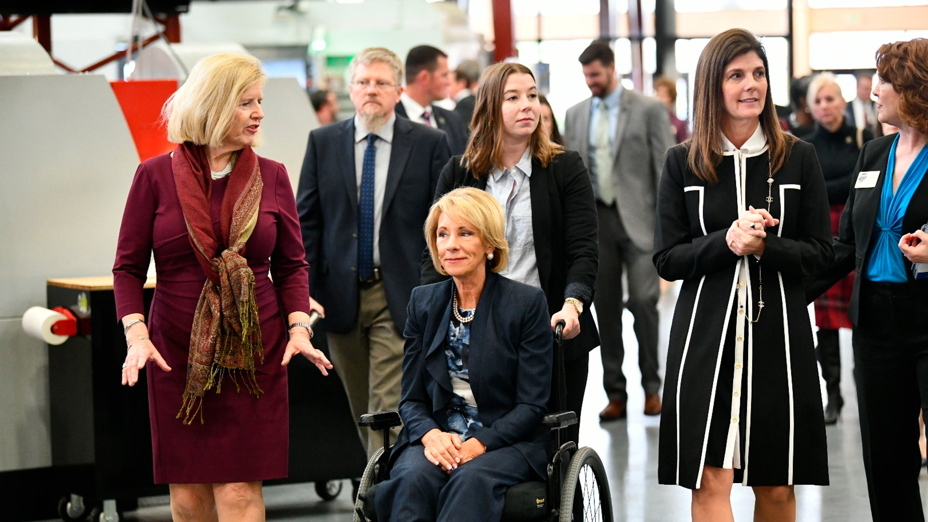 "U.S. Secretary of Education Betsy DeVos, seated, tours a technical college in Florence, S.C., Thursday, Feb. 21, 2019, with state Education Superintendent Molly Spearman, left, and Lt. Gov. Pamela Evette, right. DeVos made a trip to the state to visit an area once known as the ""Corridor of Shame"" where officials say dramatic improvements have been made in schools since state officials took over their control last year. (AP Photo/Meg Kinnard)"